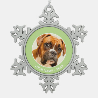 Boxer puppy on ivory cream backdrop. pewter snowflake decoration