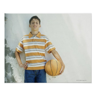 Boy (12-13) standing in front of white poster