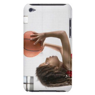 Boy aiming a shot with a basketball in a school iPod touch case