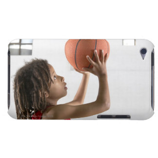 Boy aiming a shot with a basketball in a school barely there iPod cover