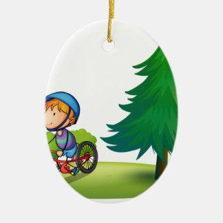 Boy and bike ceramic ornament
