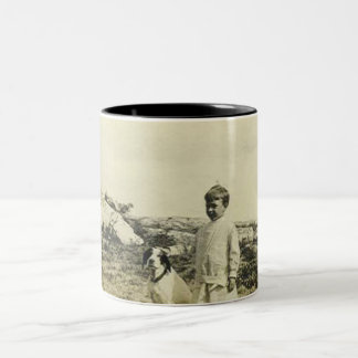 Boy and dog on cliff mugs