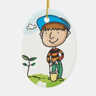 Boy gardening, tree planting ceramic oval decoration