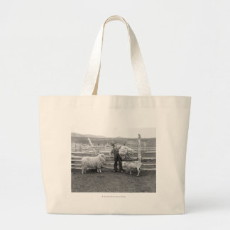 Boy holding up a bundle of wool large tote bag