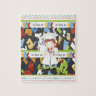 Boy in Cap and Gown with Diploma on ABC Background Jigsaw Puzzle