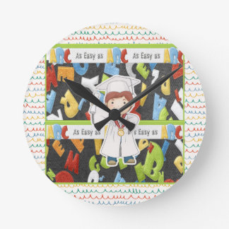 Boy in Cap and Gown with Diploma on ABC Background Round Clock