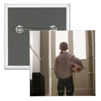 Boy in foyer with soccer ball 15 cm square badge