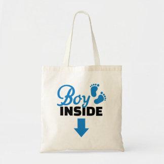 Boy inside canvas bags