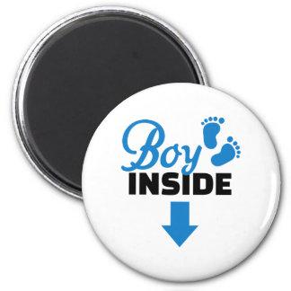Boy inside fridge magnet