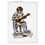 Boy playing acoustic guitar with sheet music greeting card
