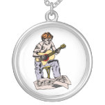 Boy playing acoustic guitar with sheet music necklaces