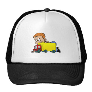Boy playing with truck cap