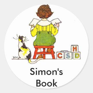 Boy reading round sticker