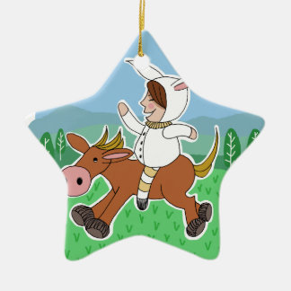 Boy riding a horse ceramic ornament