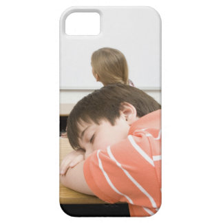 Boy sleeping on desk in classroom iPhone 5 covers
