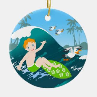Boy surfing big wave and seagulls round ceramic decoration