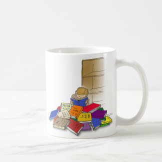 Boy toddler surrounded by books coffee mugs