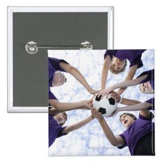 Boys holding soccer ball in huddle 15 cm square badge