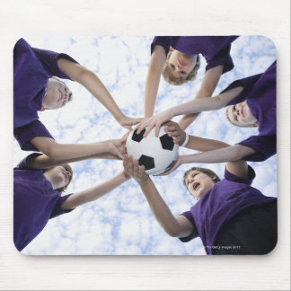 Boys holding soccer ball in huddle mouse pad