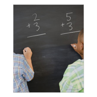Boys solving math problems on blackboard poster
