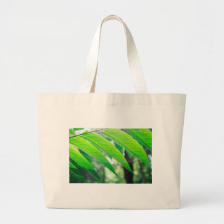 Branch ailanthus with narrow leaves large tote bag