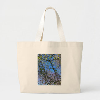 Branches and blue sky jumbo tote bag