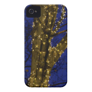 Branches with Christmas lights and a dark blue sky iPhone 4 Case-Mate Cases
