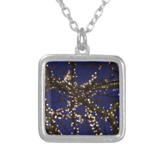 Branches with Christmas lights and a dark blue sky Silver Plated Necklace