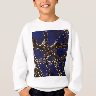 Branches with Christmas lights and a dark blue sky Sweatshirt
