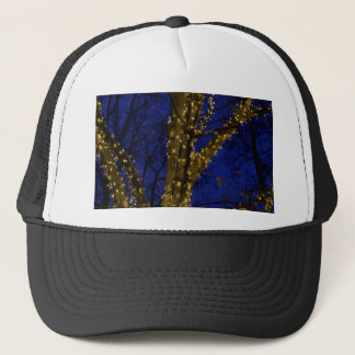 Branches with Christmas lights and a dark blue sky Trucker Hat