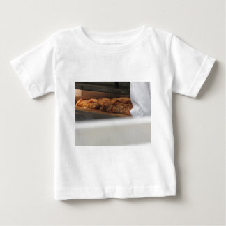 Bread freshly made into the oven baby T-Shirt