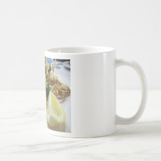 Breaded and fried crunchy vegetables with lemon coffee mug