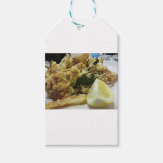 Breaded and fried crunchy vegetables with lemon gift tags