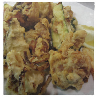 Breaded and fried crunchy vegetables with lemon napkin