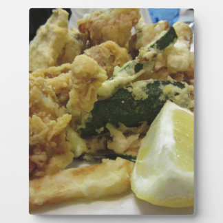 Breaded and fried crunchy vegetables with lemon plaque