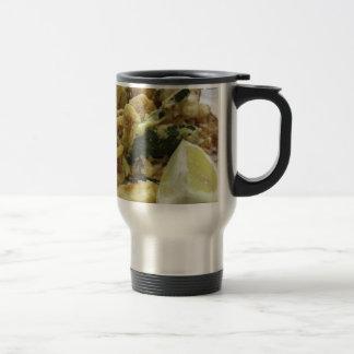 Breaded and fried crunchy vegetables with lemon travel mug