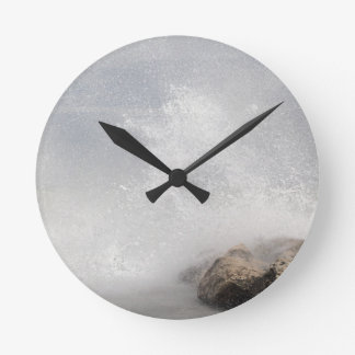 Breaking waves on rocks on the Adriatic Sea. Clocks