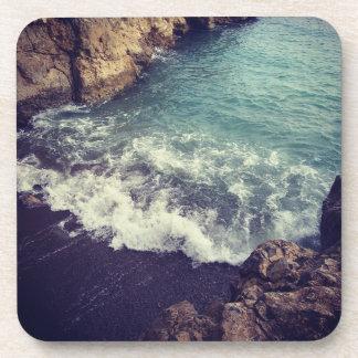 Breathtaking ocean waves crashing into shore coaster