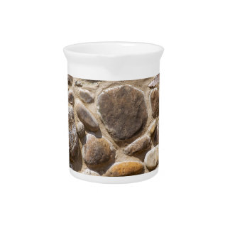 Brick and stone wall beverage pitcher
