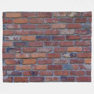 Brick wall - red mixed bricks and mortar fleece blanket