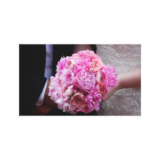 Bride & Groom hold bouquet Stretched Canvas Print