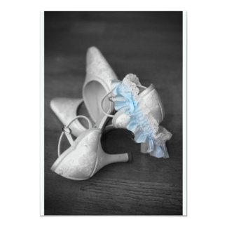 Brides shoes and garter on wedding invitation