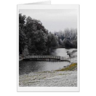 Bridge over icy water greeting card