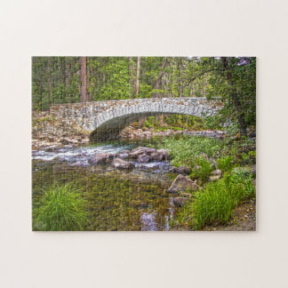 Bridge over sparkling stream jigsaw puzzle