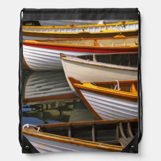 Bright colored boats at the Wooden Boat Center Backpacks