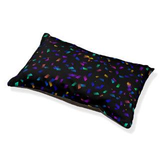 Bright colorful neon confetti on dark pet bed