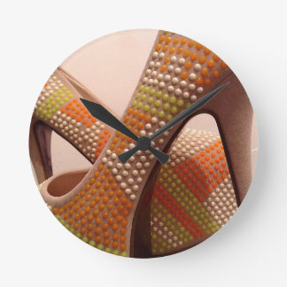 Bright coloured orange green yellow white shoes round clock