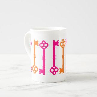 Bright orange and hot pink old keys bone china mug
