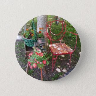 Bright orange garden chair 6 cm round badge