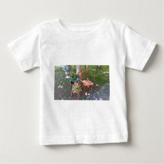 Bright orange garden chair baby T-Shirt